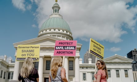 Demonstrators before a rally to protest the closure of the last abortion clinic in Missouri on 30 May, in St Louis, Missouri.