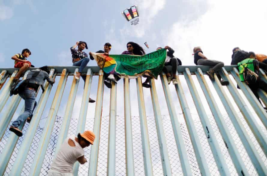 The border fence demonstrators in Tijuana, 29 April. The banner reads Diversity without borders