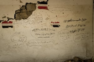 Graffiti on a wall inside the Houthi held ministry of central government building, which was bombed from the air