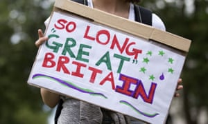 A demonstrator holds a placard that reads 'So Long Great Britain'