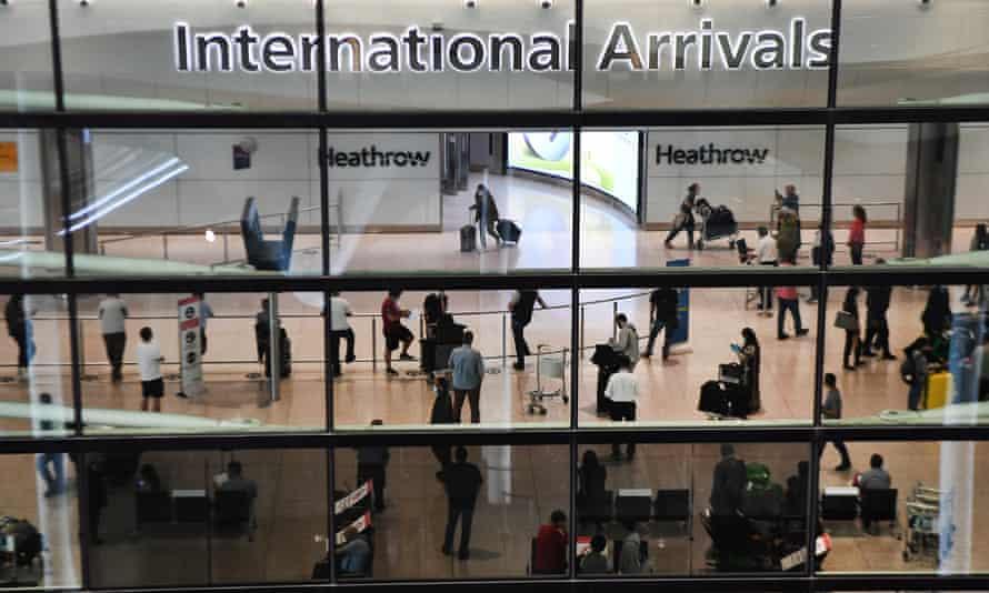 Passengers arrive at Heathrow airport in London