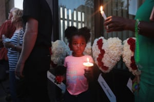 Dayton, Ohio: Mariah, six, attends a memorial service with her mother, Kristie Holt