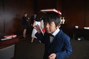 Alex Gao tries to balance a book on his head