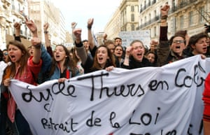 Students raise their fists and shout slogans during a demonstration in Marseille, southern France, Wednesday, March, 9, 2016. France's transport unions and youth organizations hold strikes, amid anger over proposed labor law changes that target the 35-hour workweek and make layoffs easier. (AP Photo/Claude Paris)