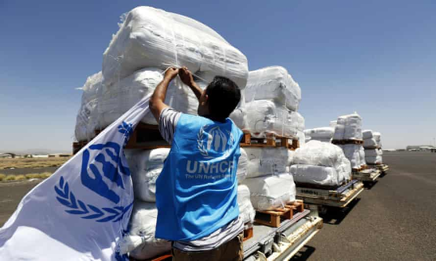 A UN worker in Yemen inspects emergency aid arriving at Sana'a airport