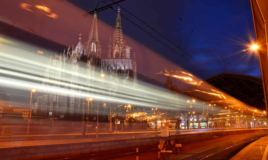 train in motion at Central Station Cologne,  Cathedral in background