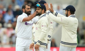 India's Mohammed Shami (left) celebrates with teammates after taking the wicket of England's Craig Overton for 32.