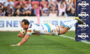 Tyrone Roberts of the Titans scores a try during the Round 13 NRL match between the Brisbane Broncos and the Gold Coast Titans.