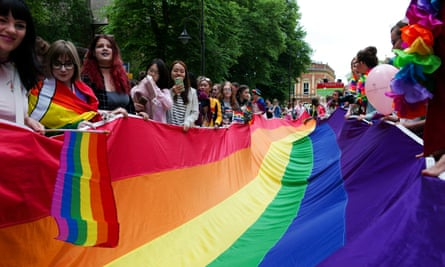 People hold a rainbow flag during the 2018 Pride parade in York