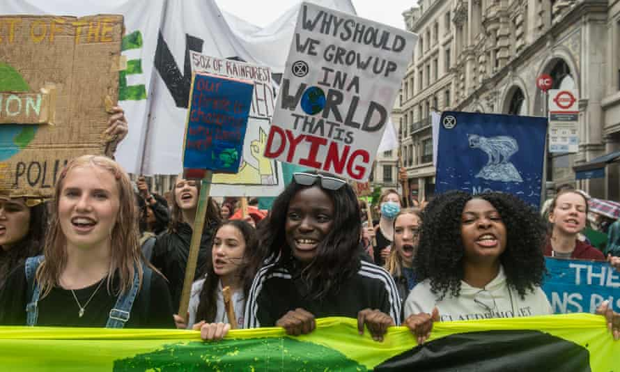 Young climate protesters march through London in July