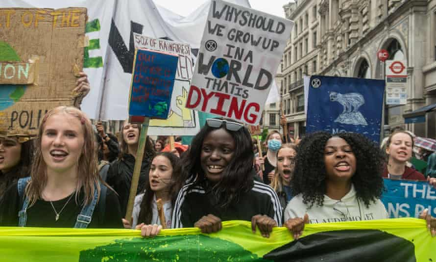Children take part in school climate strikes in London this month.