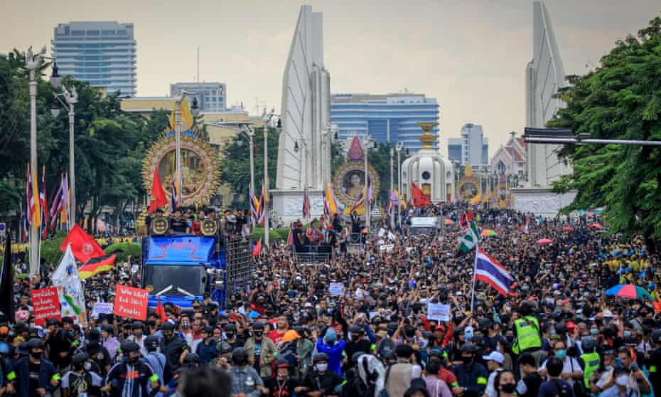 Protesters march during an anti-government protest in Bangkok