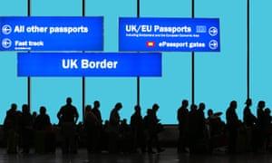 New arrivals wait at Heathrow airport's border control