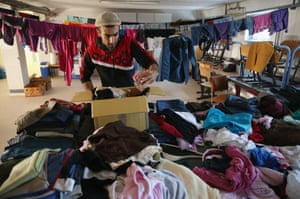 Mohamed Zayat, a refugee from Syria, looks through donated clothing