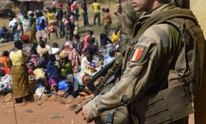 A French soldier taking part in Operation Sangaris guards people seeking refuge at a church in Boali, Central African Republic.