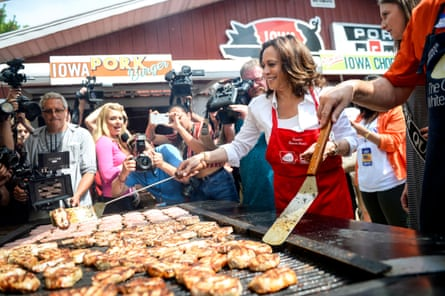Democratic presidential candidate Kamala Harris flips a pork chop at the Pork Tent at the Iowa State Fair.
