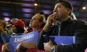 Supporters listen as democratic presidential candidate Senator Bernie Sanders speaks during a rally at Barker Hangar in Santa Monica, California.