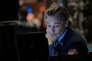 Traders work on the floor at the New York Stock Exchange (NYSE).