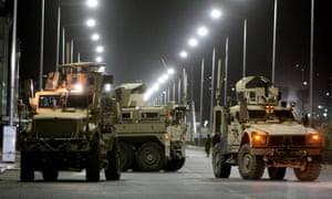 US military vehicles block the road near Camp Integrity after Taliban fighters tried to storm it on Friday.