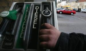 A man serves diesel to a customer