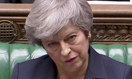 Theresa May looking serious in the House of Commons