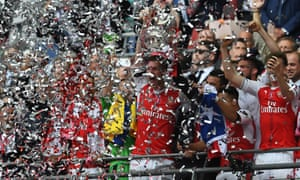 Per Mertesacker and Laurent Koscielny of Arsenal lift The FA Cup.