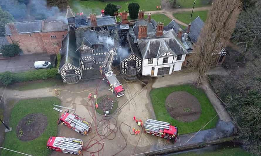 An aerial view of firefighters battling the blaze at Wythenshawe Hall in Manchester.