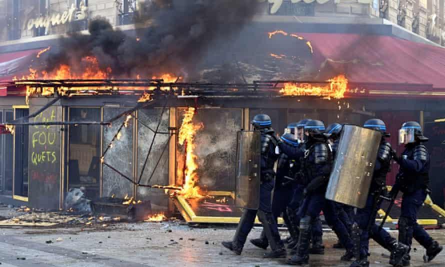 Gilets jaunes protesters set on fire the 'Le Fouquet's' restaurant on the Champs-Élysées.