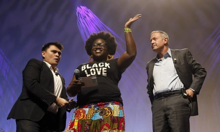 Tia Oso of the National Coordinator for Black Immigration Network joins Jose Vargas and Martin O'Malley onstage.