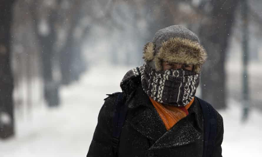 A man walks on a snow-covered road in Sarajevo, Bosnia.