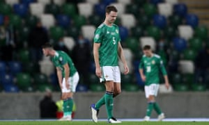 Jonny Evans, who will be 33 in March, looks dejected after Slovakia's extra-time goal against Northern Ireland in the Euro 2020 play-off final.