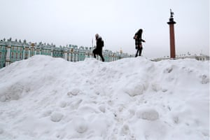 Girls climb piles of snow in Dvortsovaya (Palace) Square near the Winter Palace after a heavy snowfall in St Petersburg, Russia.