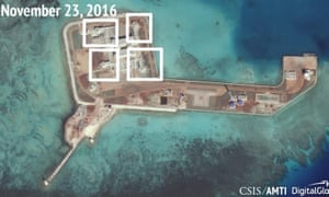 A satellite image of what appears to be anti-aircraft guns and other systems on the artificial island Hughes Reef in the South China Sea.