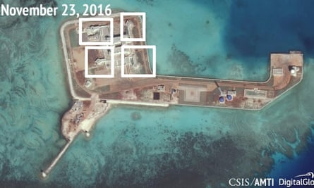A satellite image shows what the Asia Maritime Transparency Initiative says appears to be anti-aircraft guns and close-in weapons systems (CIWS) on the artificial island Hughes Reef in the South China Sea.