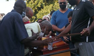 Neilton da Costa Pinto at the funeral of his son João Pedro Matos Pinto, 14.