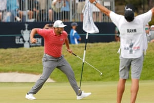 Joy for Jon Rahm and his team at the 18th.
