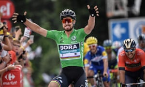 Peter Sagan celebrates as he crosses the finish line ahead of Italy's Sonny Colbrelli.