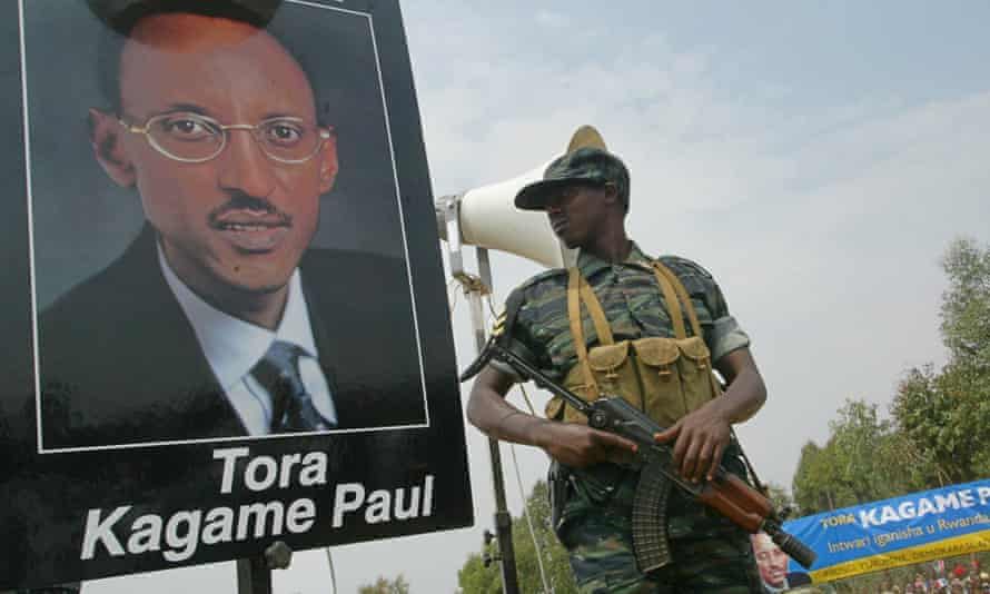 A Rwandan soldier next to a poster of Paul Kagame at a campaign rally in 2003.