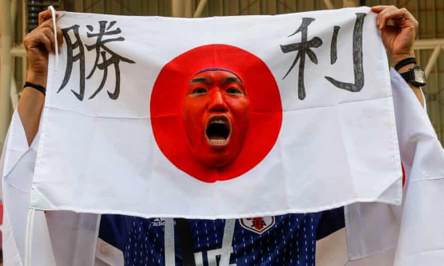 A Japanese football fan celebrates the win.