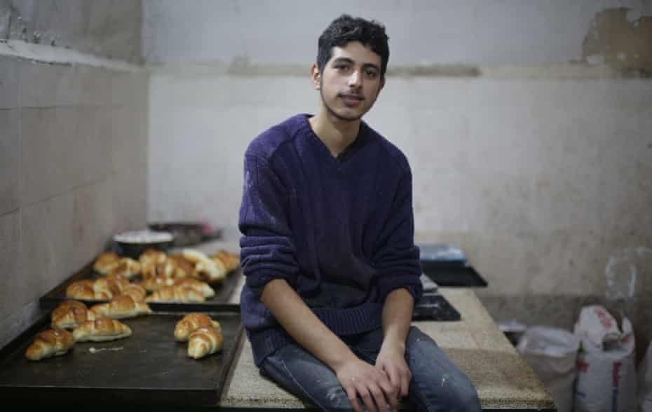 Mohammed Omran Injeela, aged 20, works in a shop selling pastries in al-Bab, Syria.