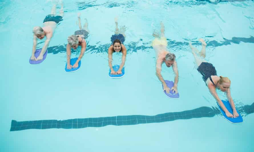 Swimmers with trainer in a pool
