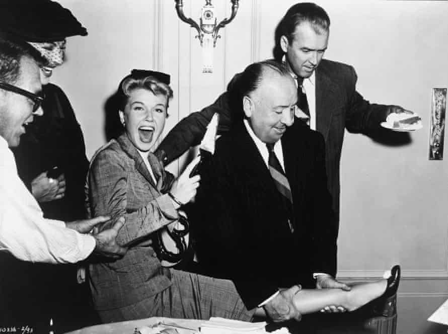 Doris Day with Alfred Hitchcock, second from right, and James Stewart, right, on the set of The Man who Knew Too Much in 1956.