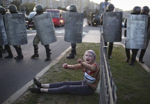 A woman reacts in front of a police line during a rally in Minsk, Belarus