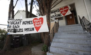 Signs are posted outside of a house that was occupied by homeless women in Oakland, California, on 14 January.