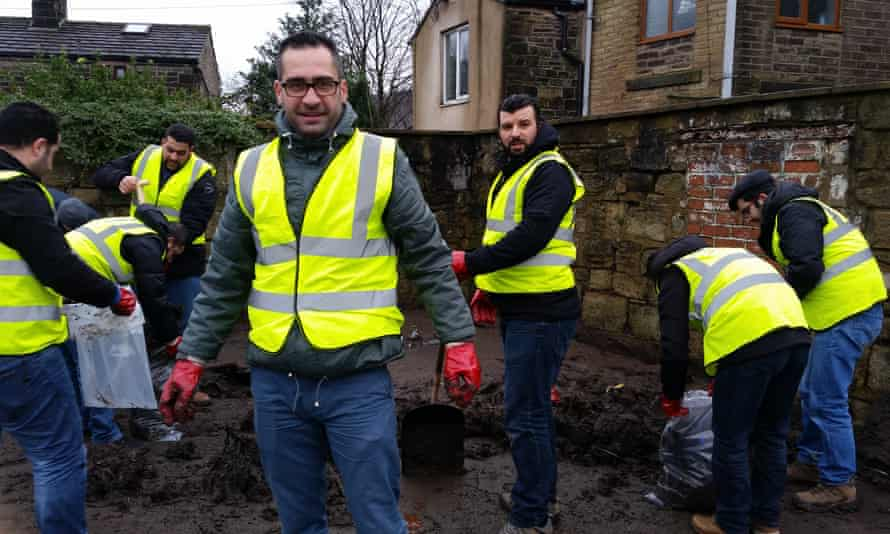 A group of Syrian refugees helping out with flood efforts in Hebden Bridge