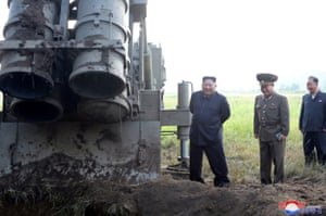 North KoreaNorth Korean leader Kim Jong Un attends the testing of a super-large multiple rocket launcher