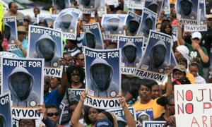 Protesters hold signs during a march and rally for Trayvon Martin in 2012.