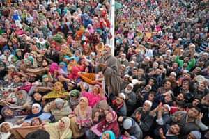 Srinagar, Kashmir Muslims pray as a cleric displays a holy relic, believed to be a hair from the Prophet Muhammad's beard, during the celebrations for Miraj-Ul-Alam