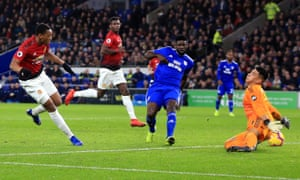 Anthony Martial of Manchester United scores his team's third goal.