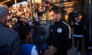 Hakeem al-Araibi greets the crowd at the football ground